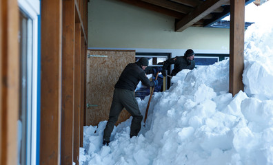 Austrian army members shovel snow after heavy snowfall in Werfenweng