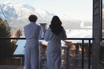Couple looking at view from balcony