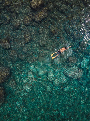 Indonesia, Bali, Man swimming in ocean at Amed beach