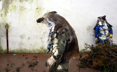 Basque revellers wear wild boar skins during traditional carnival in northern Spain.
