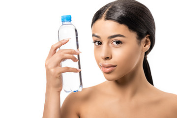 beautiful naked african american woman holding bottle of water and looking at camera isolated on white