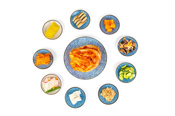Kimchi with supplements on a white background