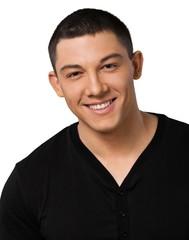 Fototapeta premium Portret uśmiechnięty młody człowiek - na białym tle