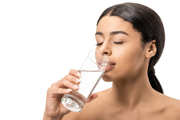 attractive young african american woman with closed eyes drinking water from glass isolated on white