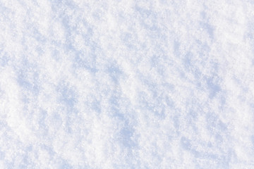 Texture of the white fluffy snow for background