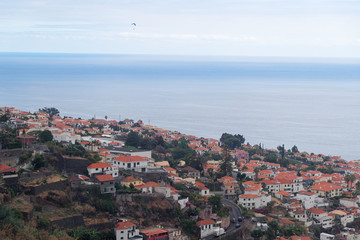 Aerial view at Funchal city and sea water from Monte on Madeira island