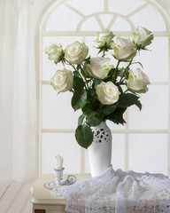 Still life with bouquet of white roses