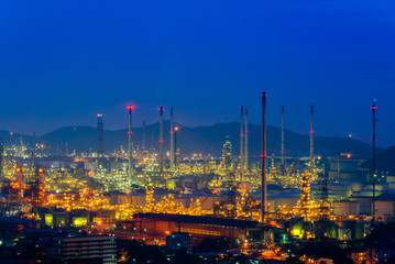Industrial power plant oil station night landscape. Backgrounds Industrial power plant oil station.