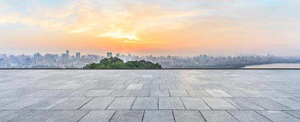 Panoramic city skyline and buildings with empty square floor at sunrise Fotomurales