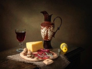 Still life with red wine and smoked meat