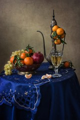 Still life with fruits and white wine