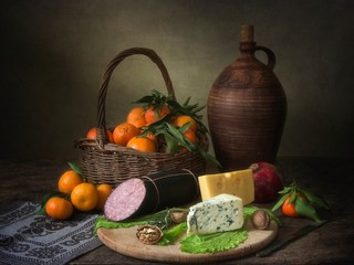 Still life with a  tangerines and salami