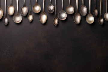 Old vintage spoons on stone table