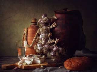 Still life with garlic and bacon