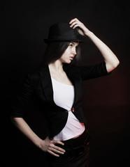 Fotobehang womenART stylish young woman in black hat posing for the camera