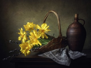 Still life with bouquet of yellow tulips