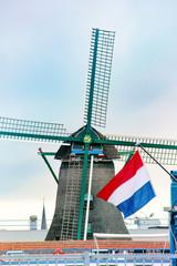 Windmill in Zaanse Schans with Flag - Netherlands