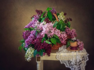Still life with bouquet of multicolored lilac