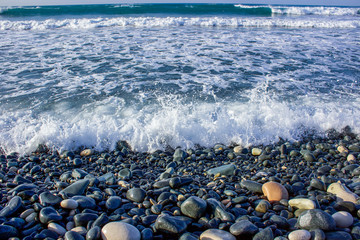 Energy of the Sea and multi-coloured pebbles for a natural wallpaper/background beach pattern, tourism waiting for summer