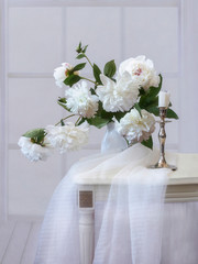 Still life with bouquet of white peonies