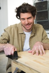 Male carpenter working on wood