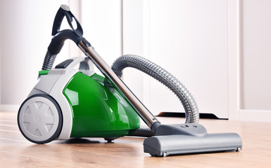 Canister vacuum cleaner for home use on the floor panels