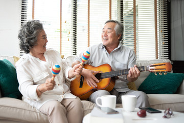 Asian senior Couple Having fun.