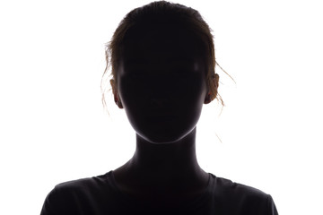 silhouette of a girl confidently looking forward, a young woman's head with a curl on a white isolated background