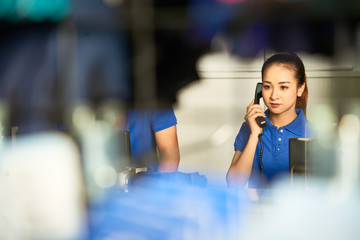 Pretty female shop assistnat consulting customer on the phone