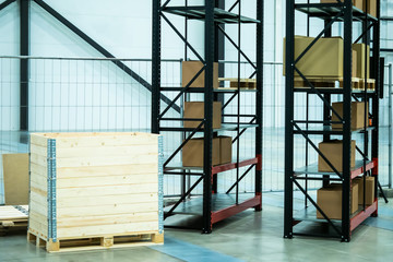 Stock. Postage Shipment. Metal rack for storage of goods. Shelves with boxes. Storage. Storage system Cardboard boxes.