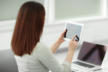 business woman with digital tablet in the workplace.