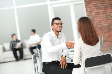 handshake of business people in the Bank office.