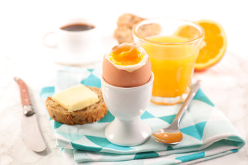 breakfast with boiled egg, coffee and orange juice