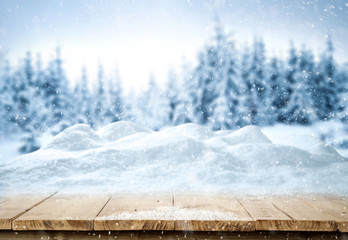 Table background with snow and free space for your decoration