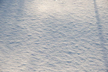 the natural background - snow surface in sunshine