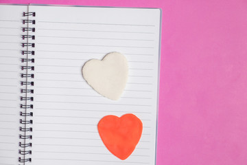 Big 2 hearts in blank book on pink background with space for text, Love icon, valentine's day, relationships concept