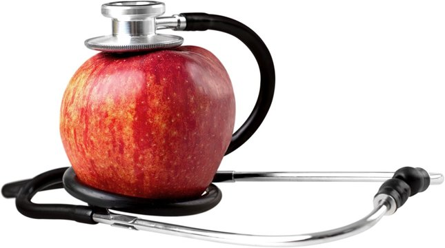 Stethoscope and an apple