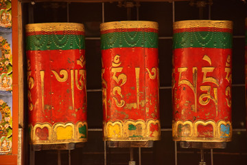Traditional Buddhist rotating prayer wheels