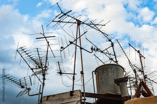Multiple Home TV antennas mounted on a rooftop of an ...