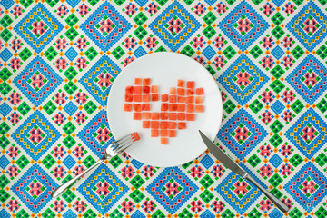 Pixel Heart. Watermelon pieces folded in the shape of heart of pixels.