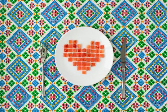 Pixel Heart. Watermelon pieces folded in the shape of heart of pixels.