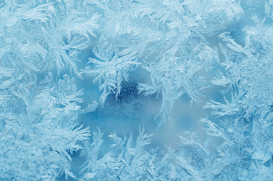 Abstract frosty pattern on glass, background texture
