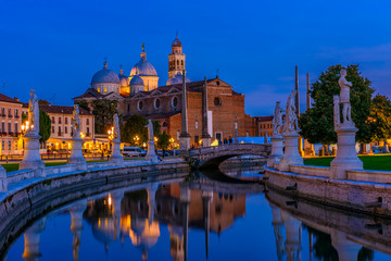 Wall Mural - View of canal with statues on square Prato della Valle and Basilica Santa Giustina in Padova (Padua), Veneto, Italy
