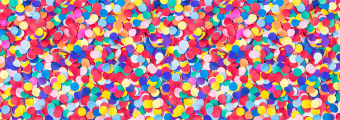 Colorful, round confetti as background for carnival, New Year's Eve, banner