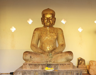 A Buddha statue at That Luang stupa temple, Vientiane, Laos