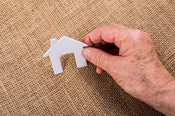 Little paper house on a linen canvas