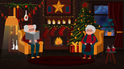 grandparents sit by the fireplace at Christmas