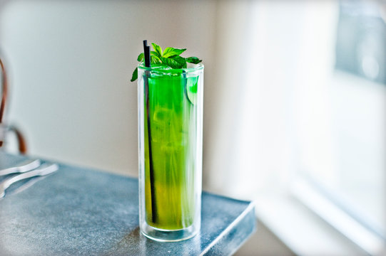 Green Cucumber, Mint and Lime Drink in Glass on Table