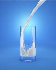 Glass of fresh milk with pouring and splash. Isolated On blue background.