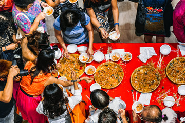 Chinese traditional food at the Chinese new year celebration. People try Chinese food.